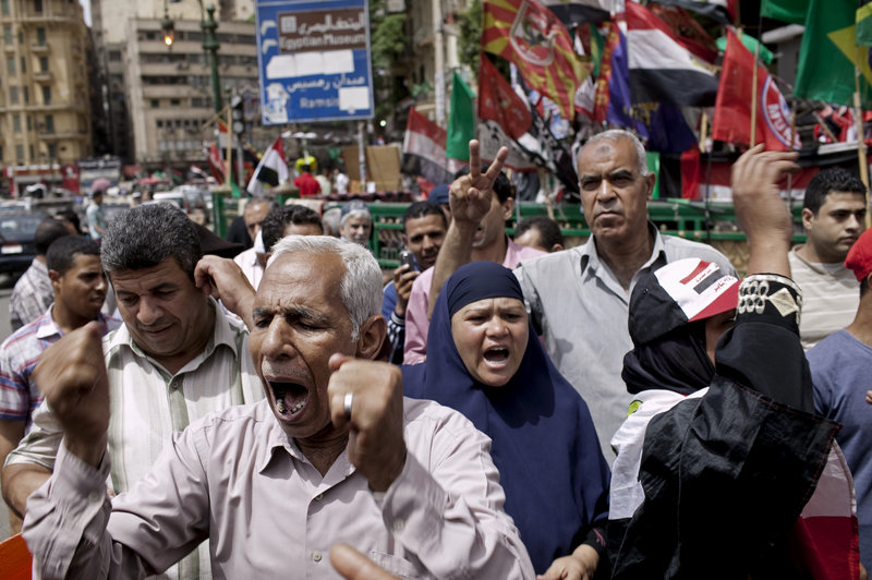 Egyptian demonstrators denounce the electoral success of Ahmed Shafiq, a former prime minister, in Cairo on Friday. Shafiq faces a runoff vote against an Islamist candidate.