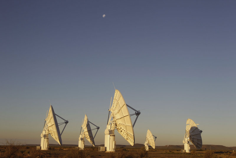 Telescope dishes stand near the town of Carnarvon, South Africa, a remote site in the Karoo desert where dishes will be added for the proposed Square Kilometer Array radio telescope project.