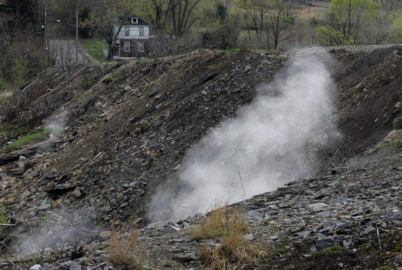 Steam from burning underground coal rises from the ground in Centralia, Pa., 50 years after a fire at the town dump spread to an underground network of coal mines. Eventually, the town was evacuated and demolished, except for a few holdouts.