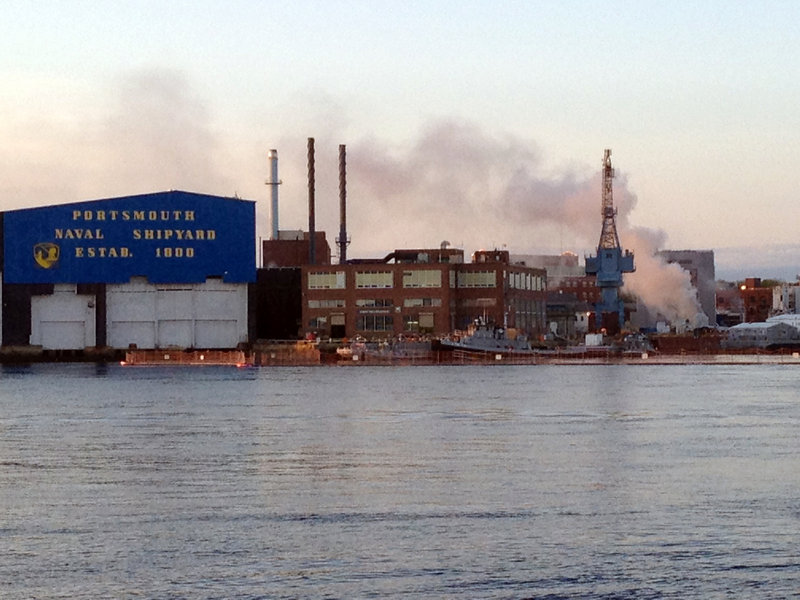 A fire burns on the nuclear submarine USS Miami at the Portsmouth Naval Shipyard in Kittery on Wednesday. Navy investigators have begun the first damage assessment and will try to help determine what caused the blaze.