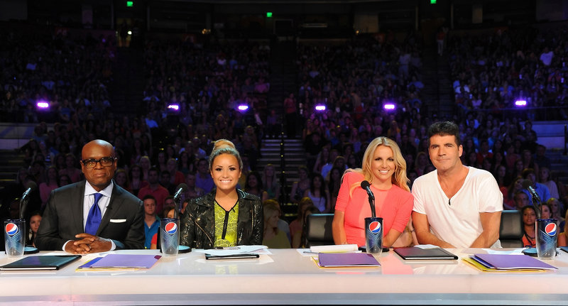 """The X Factor"" judges are, from left, L.A. Reid, Demi Lovato, Britney Spears and Simon Cowell, shown Thursday on the singing-contest show in Austin, Texas."