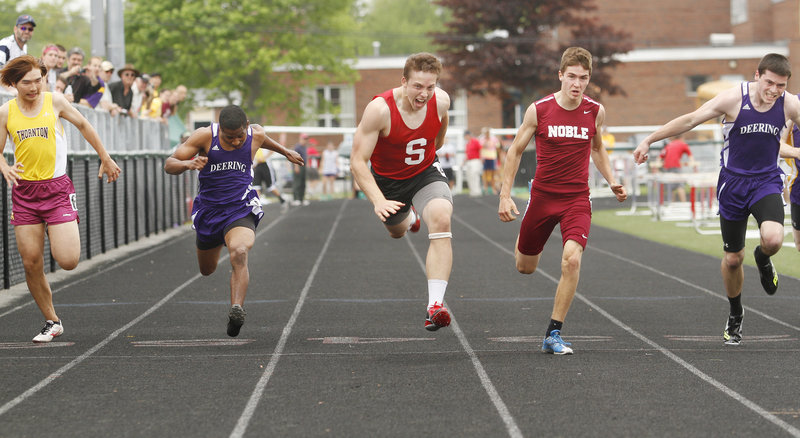 Alex Shain, center, of Sanford pops across the finish line to win the 100 meters in 11.34 seconds, upsetting top-seeded Ethan Beaulier of Noble in the Southern Maine Activities Association outdoor track and field meet Saturday, Shain was the meet's boys' MVP.