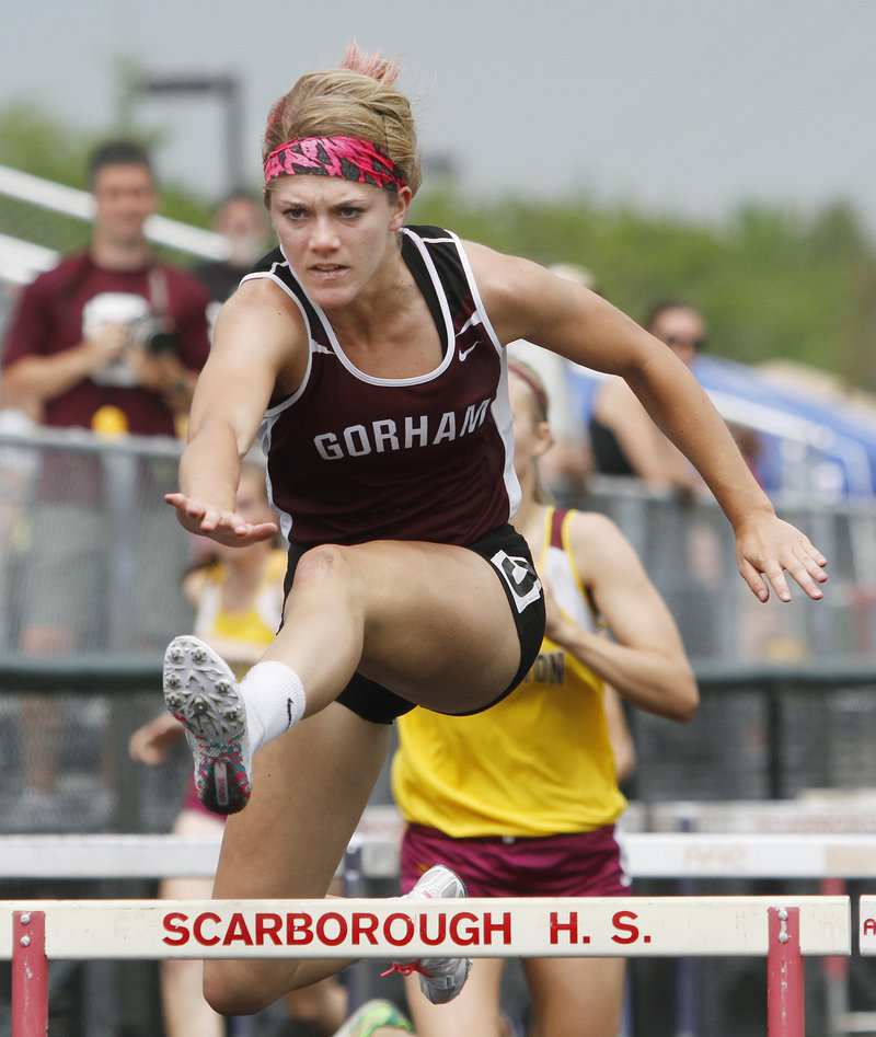 Sarah Perkins of Gorham, who was the SMAA athlete of the meet among the girls, takes the 100-meter hurdles in 15.18 seconds. She also won the 300 hurdles.