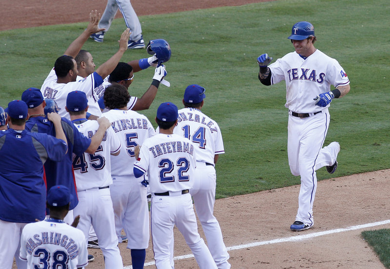 Josh Hamilton approaches home plate after hitting a game-ending home run for the Texas Rangers in an 8-7 win over the Blue Jays on Saturday.
