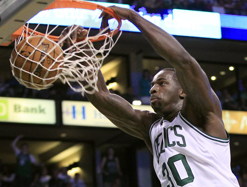 Brandon Bass of the Boston Celtics gets a close look at the basket Saturday, dunking the ball against the Philadelphia 76ers in Game 7 of their playoff series. The Celtics won, 85-75.