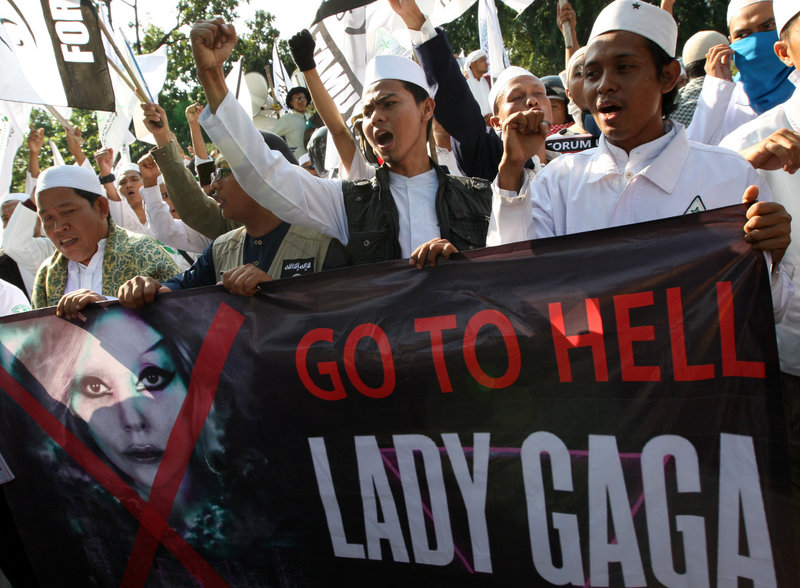 Muslim men shout slogans during a rally against pop singer Lady Gaga's concert, which had been scheduled for June 3, outside the U.S. Embassy in Jakarta, Indonesia, on Friday. The concert was canceled Sunday.