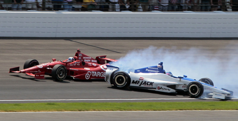 Dario Franchitti maintains his lead as Takuma Sato spins out while trying to pass on the last lap of the Indianapolis 500 on Sunday. Franchitti won for the third time.