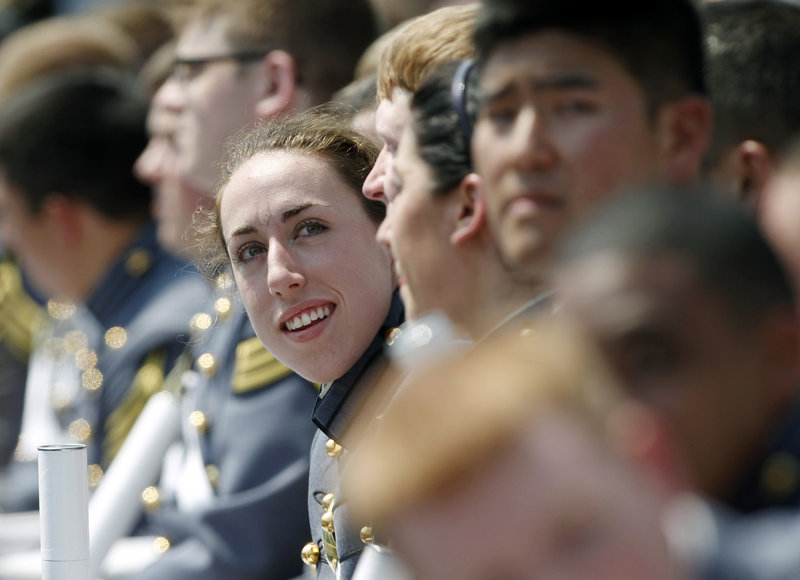 "Cadet Kaitlyn Kelly, 22, shown at a West Point graduation and commissioning ceremony, is pleased she could take her civilian girlfriend to a gay advocacy group's dinner. ""I had taken her to previous things, said Kelly, ""... but I had to do the ambiguous, 'Oh, she's my best friend.'"""