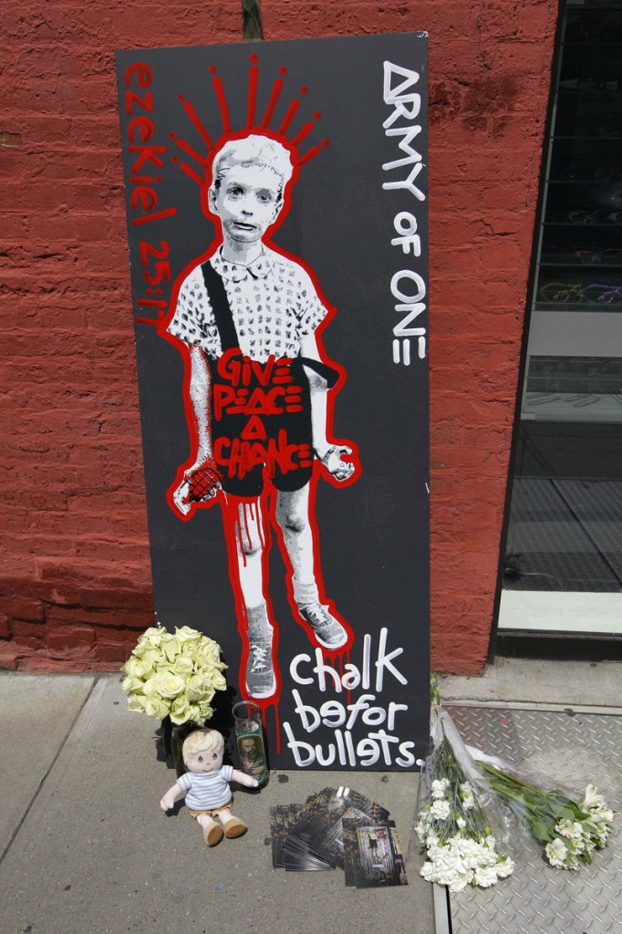 Artwork and other items form a makeshift memorial Sunday at the site in New York where a suspect claims to have strangled Etan Patz, who was 6 when he disappeared in 1979.
