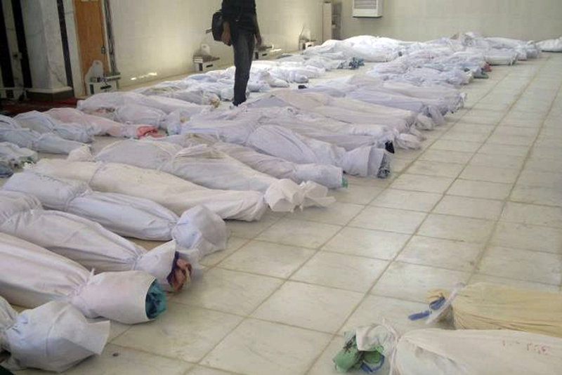 A photo taken by a citizen journalist on Saturday purports to show shrouded dead bodies following an assault on Houla, Syria.