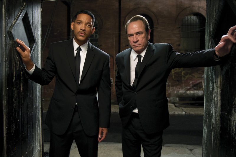 "Will Smith, left, and Tommy Lee Jones reprise familiar roles in ""Men In Black 3."