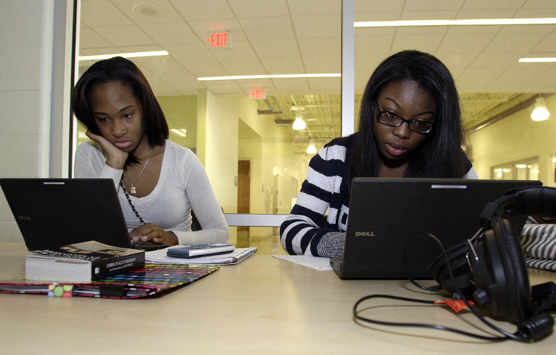 Raeven Hammond, left, and Hillary Kounkorgo participate in a pilot math class at Reynoldsburg High School in Reynoldsburg, Ohio. The classes aim to help students avoid having to take remedial classes in college. New research finds that remedial college classes largely fail to advance higher education.
