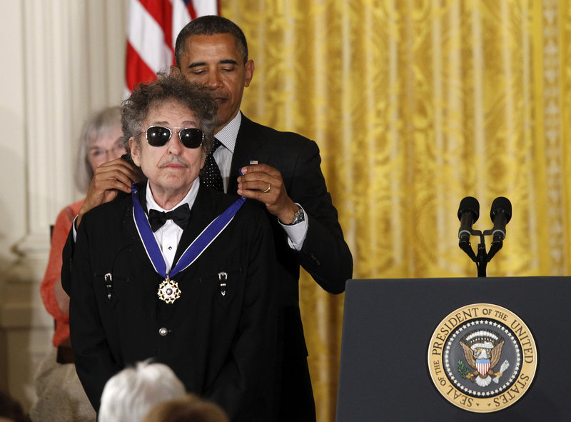 President Obama presents rock legend Bob Dylan with a Medal of Freedom during a ceremony Tuesday at the White House in Washington.