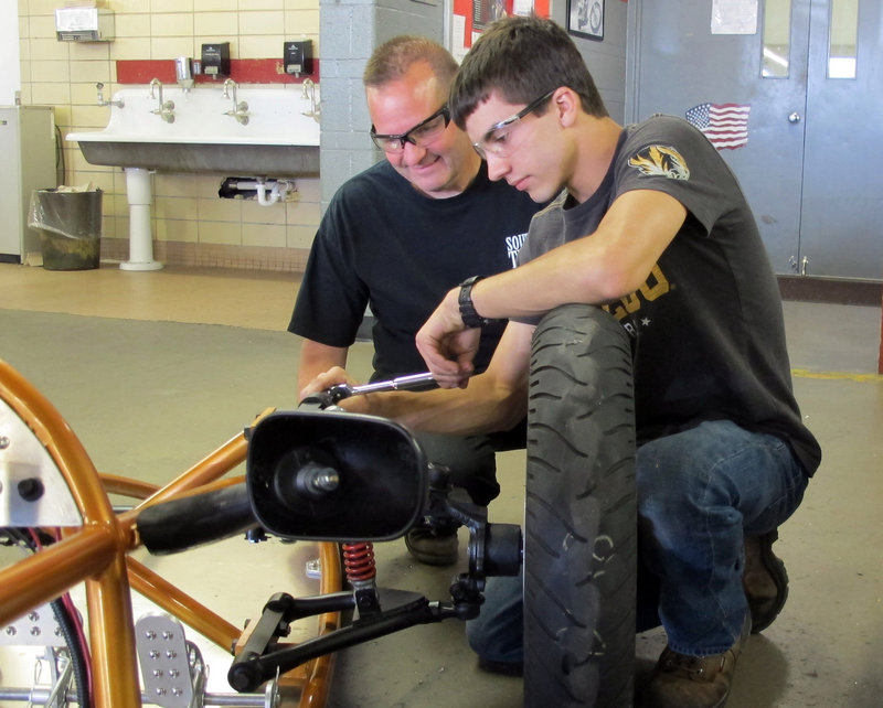 Bob Arcipowski, a precision machining expert, works with student Mike Finklang at South Tech High School in Sunset Hills, Mo., earlier this month.