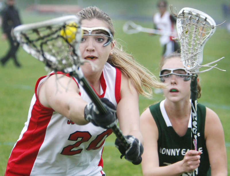 Olivia Edwards of South Portland keeps possession while pressured by Jordan Ray of Bonny Eagle during South Portland's 10-7 victory Tuesday.