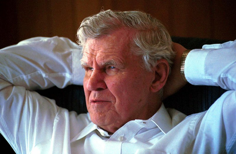 Doc Watson, shown in 2000, was revered by younger musicians for his guitar-playing talent, but his generosity put them at ease.
