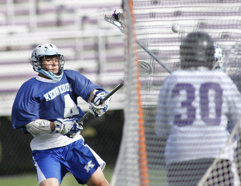 Harrison Hall of Kennebunk fires a first-quarter shot Wednesday during the 10-4 victory against Deering that ended the schoolboy lacrosse regular season. Kennebunk finished with a 9-3 record. Deering was 7-5.