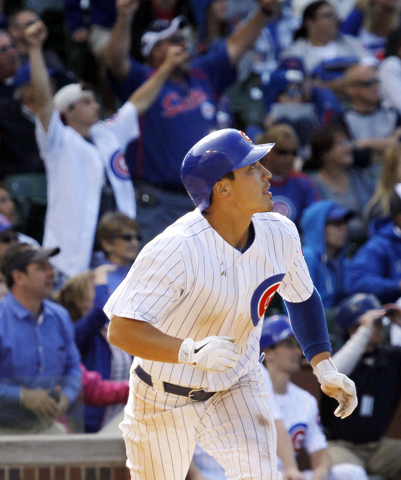 Darwin Barney watches his two-run homer in the bottom of the ninth inning on Wednesday that gave the Cubs an 8-6 win over the San Diego Padres in Chicago.
