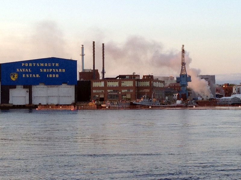 A fire burns in a nuclear submarine at the Portsmouth Naval Shipyard in Kittery, on Wednesday. The cause of the fire inside the USS Miami SSN 755 has not yet been identified.