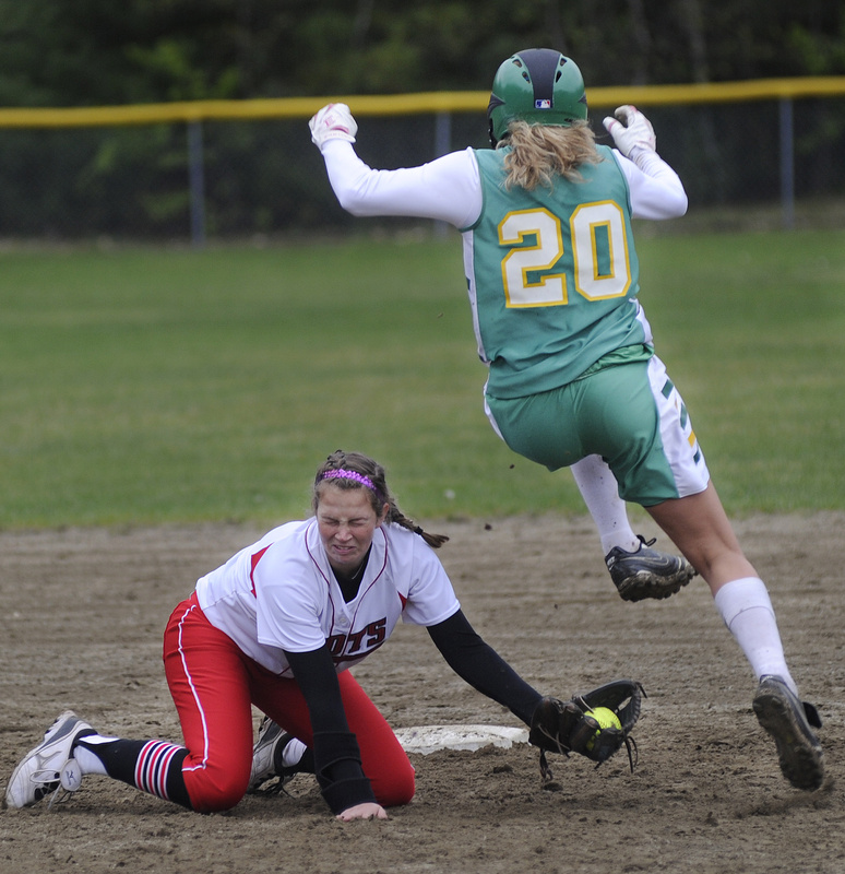 Regan Adams of Massabesic leaps over an attempted tag by South Portland shortstop Danica Gleason to reach second base Wednesday during their Southern Maine Activities Association softball game. South Portland earned a 17-0 victory at home.