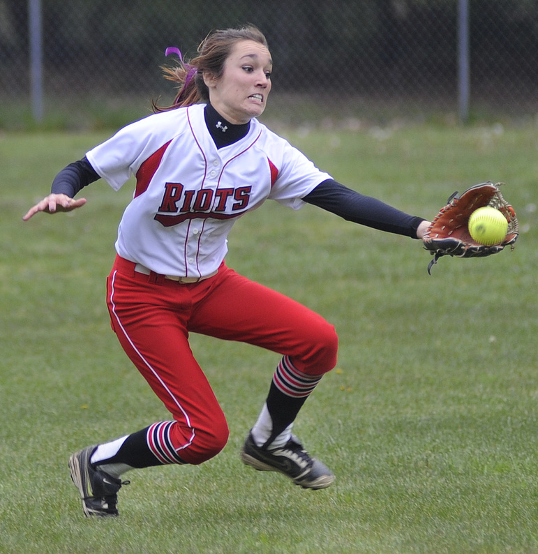 Kelsey Morton of South Portland takes control in the outfield and darts in to make a running catch against Massabesic.