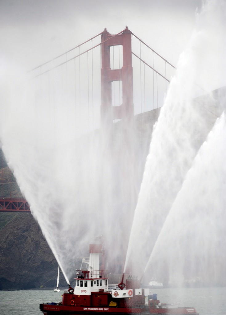 The Phoenix fireboat sprays plumes of water as part of the Golden Gate Bridge's 75th anniversary celebration Sunday in San Francisco.