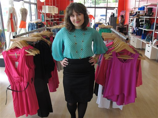 In this photo taken Thursday, May 31, 2012, in Anchorage, Alaska, Hillary Walker, the assistant manager at lulu e. bebe fashion boutique in Anchorage. Travel and Leisure poll readers have named Anchorage residents as the nation's worst-dressed. Walker finds the poll