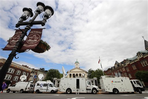 Television satellite trucks set up outside the Centre County Courthouse in Bellefonte, Pa., Monday, June 4, 2012, in preparation for the start of the child sexual abuse trial of former Penn State college football assistant coach Jerry Sandusky, on Tuesday. (AP Photo/Gene J. Puskar)