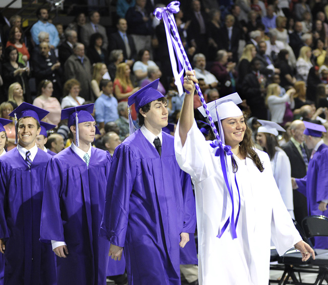 Caley Presby leads half of the processional as the Deering High School Class of 2012 begins commencement exercises today at the Cumberland County Civic Center in Portland.