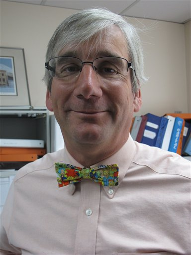 In this photo taken Thursday, May 31, 2012, in Anchorage, Alaska, State of Alaska labor economist Neal Fried displays his signature bow tie, this one featuring characters from