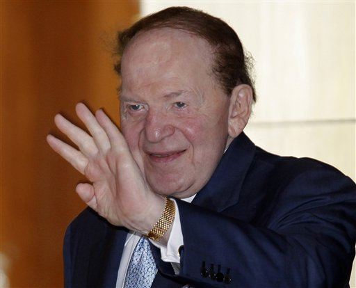 In this June 7, 2011, file photo shows Las Vegas Sands Chairman and CEO Sheldon Adelson waves in Hong Kong. After almost signle-handedly keeping alive Newt Gingrich's campaign for months, Adelson has given $10 million to a pro-Romney PAC. (AP Photo/Vincent Yu, File)