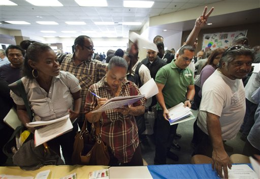 Job seekers gather for employment opportunities at the 11th annual Skid Row Career Fair at the Los Angeles Mission in Los Angeles on Thursday.