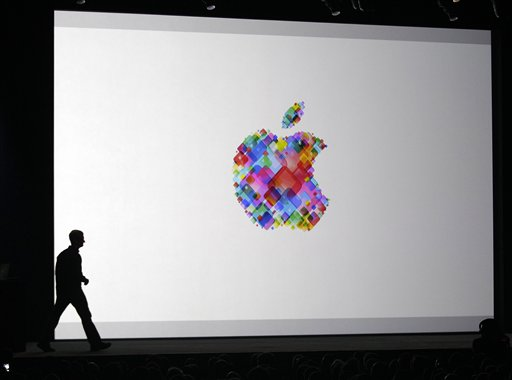 Apple CEO Tim Cook walks onstage during the Apple Developers Conference in San Francisco today.