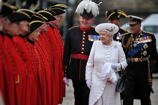 Britain's Queen Elizabeth II and Prince Philip, right, arrive at Chelsea Pier in London before boarding the royal barge to participate in the Diamond Jubilee River Pageant.