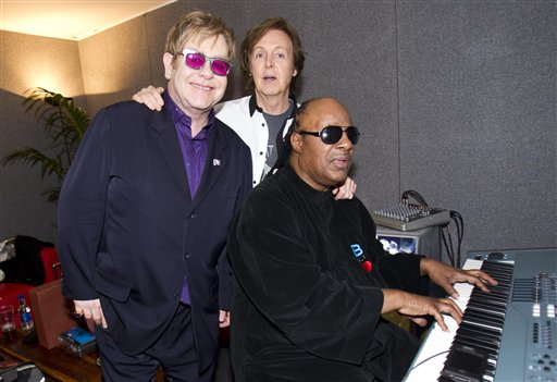Sir Paul McCartney joins Sir Elton John and Stevie Wonder backstage at the Diamond Jubilee concert at Buckingham Palace in London on Monday.