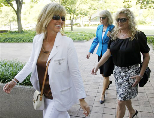 Debbie Clemens, left, wife of former Major League Baseball pitcher Roger Clemens, arrives at federal court in Washington today.