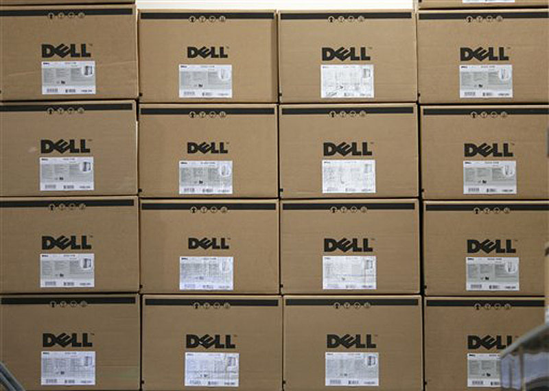 In this Aug. 16, 2008, file photo, boxes containing Dell computers are stacked on an upper shelf of a Best Buy store in Seekonk, Mass. Computer maker Dell Inc. annoucned Wednesday, June 13, 2012, that it is planning more than $2 billion in cost cuts over the next three years as its looks to transform its business so it can keep pace in the highly competitive technology sector. (AP Photo/Stew Milne)