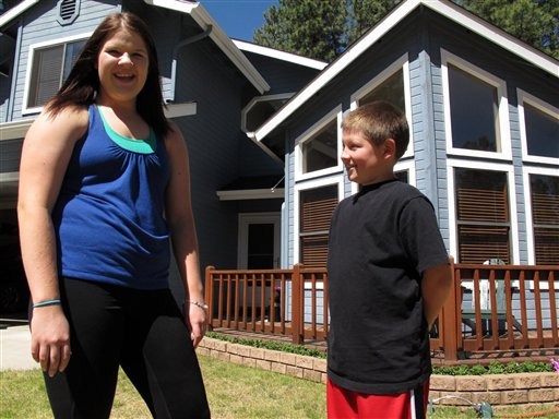 Colleen Knaggs, 18, talks about her fruitless efforts to find a summer job, from her home in Flagstaff, Ariz., recently. Instead, Knaggs will be babysitting her 10-year-old brother, Matthew Knaggs, right.