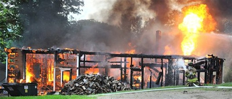 A large barn that doubled as a workshop on Patten Hill Road was hit by lightning Friday evening June 8, 2012 and burns out of control. The barn is owned by Audrey Slattery, and is known as Slatteryís Stables, offering boarding and carriage rides from the farm. (AP Photo/Russ Dillingham,Sun Journal) Russ Dillingham;hebron;fire;slattery