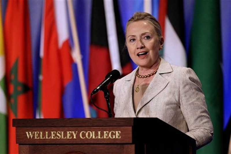 Secretary of State Hillary Rodham Clinton speaks a a gathering of the Women in Public Service Institute at her Alma mater, Wellesley College in Wellesley, Mass., Monday, June 11, 2012. (AP Photo/Stephan Savoia)