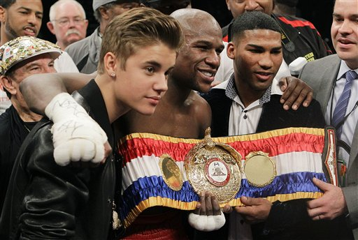 Floyd Mayweather Jr., center, poses for a photo with Justin Bieber and Yuriyorkis Gamboa after defeating Miguel Cotto for the WBA super welterweight title, on May 5, 2012, in Las Vegas.
