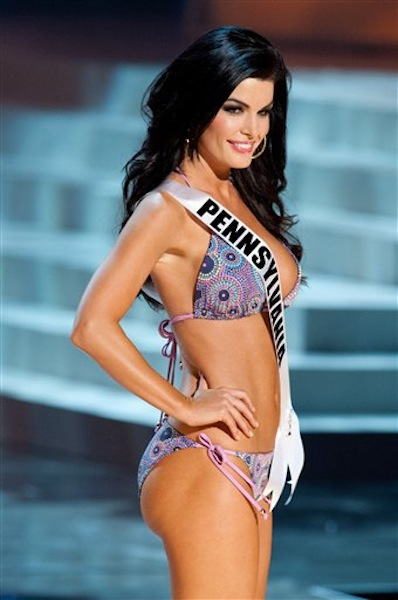 In this photo provided by the Miss Universe Organization, Miss Pennsylvania Sheena Monnin competes during the 2012 Miss USA Presentation Show on Wednesday, May 30, 2012 in Las Vegas. Monnin resigned her crown claiming the contest is rigged, but according to organizers the beauty queen was upset over the decision to allow transgender contestants to enter. A posting on Monninís Facebook page claims another contestant learned the names of the top 5 finishers on Sunday morning, hours before the show was broadcast. (AP Photo/Miss Universe Organization, Darren Decker) Miss USA 2012;Presentation Show;Swimsuit;Kooey Australia;Chinese Laundry