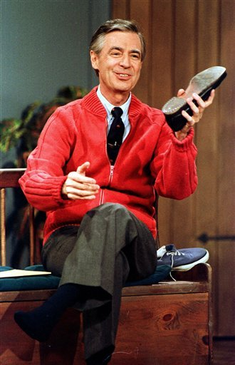 This June 28, 1989 file photo shows Fred Rogers as he rehearses the opening of his PBS show