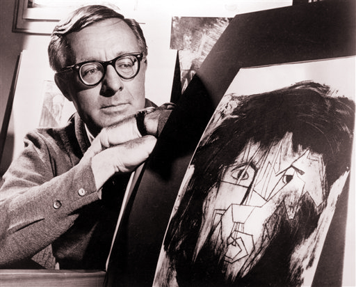 This Dec. 8, 1966, photo shows Ray Bradbury with a picture from a student project illustrating characters in a stage version of one of his dramas.