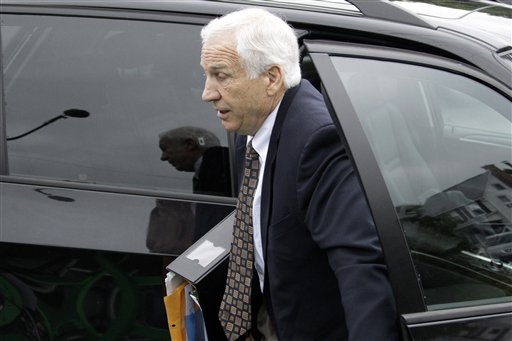 Former Penn State University assistant football coach Jerry Sandusky arrives for the second day his trial at the Centre County Courthouse in Bellefonte, Pa., today.