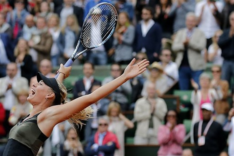 Russia's Maria Sharapova jumps after defeating Italy's Sara Errani in their women's final match in the French Open tennis tournament at the Roland Garros stadium in Paris, Saturday, June 9, 2012. Sharapova won 6-3, 6-2. (AP Photo/Michel Euler)