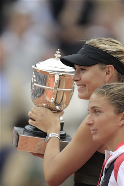 Maria Sharapova of Russia, rear, holds the trophy after winning the women's final match against Sara Errani of Italy, right, at the French Open tennis tournament in Roland Garros stadium in Paris, Saturday June 9, 2012. Sharapova won in two sets 6-3, 6-2. (AP Photo/Bernat Armangue)