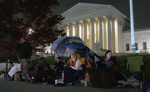People wait in line in front of the Supreme Court in Washington, D.C., on March 25, the eve of oral arguments before the court on President Obama's health care legislation.