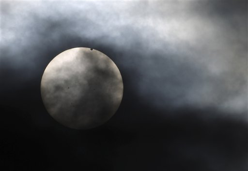 Venus begins to pass in front of the sun, as visible from New York on Tuesday.