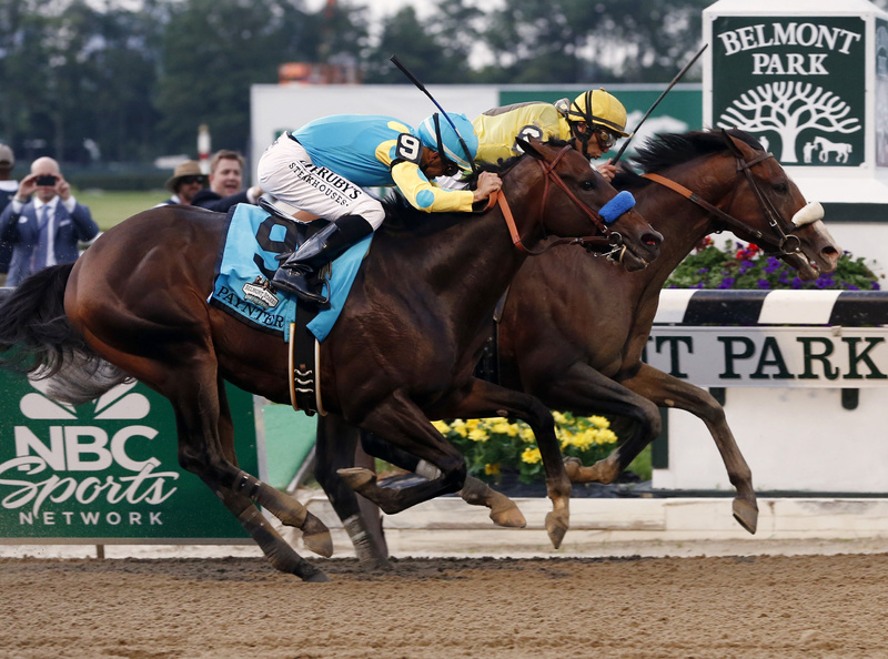 Union Rags with jockey John Velazquez, right, holds off Paynter with jockey Mike Smith to win the 144th Belmont Stakes horse race at Belmont Park in Elmont, N.Y., on Saturday.